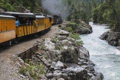Durango and Silverton Narrow Gauge Railroad Steam Engine travels along Animas River, Colorado, USA Royalty Free Stock Photo