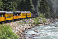 The Durango and Silverton Narrow Gauge Railroad Steam Engine travels along Animas River, Colorado, USA Stock Photos