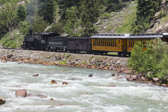 The Durango and Silverton Narrow Gauge Railroad Steam Engine travels along Animas River, Colorado, USA royalty free stock photos