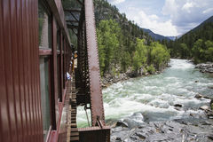 The Durango and Silverton Narrow Gauge Railroad Steam Engine travels along Animas River, Colorado, USA Stock Photo