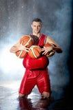 Jogador de basquetebol que olha a câmera Imagem de Stock