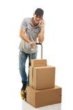 Durante uma chamada - caixas e pacotes do caminhão de mão do correio Fotografia de Stock Royalty Free