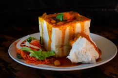 BEAN BUNNY CHOW IS NO RABBIT FOOD 01. A Durban Bunny Chow - or, in this case, a vegetarian quarter bean bunny - served with sambals. This is an iconic Durban stock photography