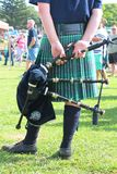 The bagpiper in traditional Scottish suit kilt with backpipe. Durban, South Africa -  May 2, 2017: The bagpiper in traditional Scottish suit kilt holding a Royalty Free Stock Photos