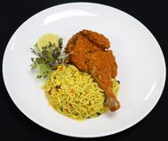 Durban style chicken with oporto rice stock photography