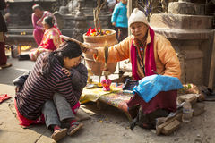DURBAR SQUARE, KATHMANDU, NEPAL - NOVEMBER 29, 2014: Monk pray f Stock Image