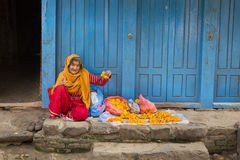 DURBAR SQUARE, KATHMANDU, NEPAL - NOVEMBER 30, 2014: Woman selli Royalty Free Stock Image
