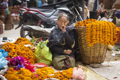 DURBAR SQUARE, KATHMANDU, NEPAL - NOVEMBER 29, 2014: Woman selli Royalty Free Stock Photography