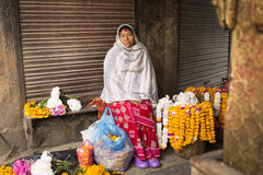 DURBAR SQUARE, KATHMANDU, NEPAL - NOVEMBER 28, 2014: Woman selli Stock Image