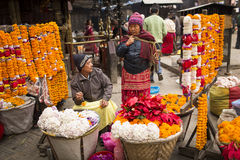 DURBAR SQUARE, KATHMANDU, NEPAL - NOVEMBER 28, 2014: Woman selli Royalty Free Stock Photography