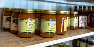 Durbin Farms Market Peach Butter. Clanton, Alabama, USA - June 17, 2017: Jars of Durbin Farms Market peach butter on display on a shelf Stock Images