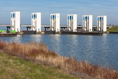 Durch discharge sluices in Houtribdijk near Lelystad. Discharge sluices in Houtribdijk between IJsselmeer and markermeer near Lelystad, The Netherlands royalty free stock image