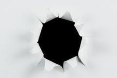 Durchbruch heftiges großes schwarzes Loch im Weißbuch Stockfoto