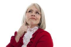 Durchdachte ältere Frau Stockfoto