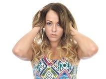 Durchdachte deprimierte unglückliche junge Frau Stockfotografie