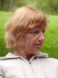 Durchdachte fällige Frau Stockbild