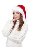 Durchdachte Frau in einem Sankt-Hut lokalisiert auf weißem Hintergrund Stockfotografie