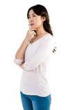 Durchdachte Frau mit der Hand auf Backe Stockfotografie