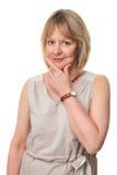 Durchdachte Frau mit der Hand zum Gesicht Stockbilder