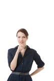 Durchdachte Frau, welche die Kamera betrachtet Stockfotos