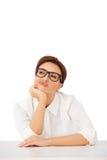Durchdachte Geschäftsfrau Stockfoto