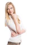 Durchdachte junge blonde Frau. Stockfotografie
