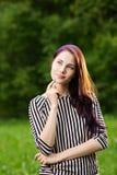 Durchdachte junge Frau Lizenzfreie Stockbilder