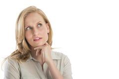 Durchdachte junge Frau, die weg schaut Lizenzfreie Stockfotos