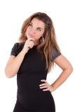 Durchdachte junge kaukasische Frau, die oben schaut Lizenzfreie Stockfotos