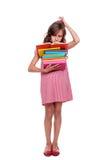 Durchdachte Schüler mit Büchern Stockbild