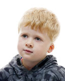 Durchdachter blonder Junge Stockfotografie