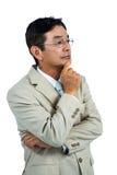 Durchdachter Geschäftsmann, der weg schaut Lizenzfreies Stockfoto