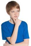 Durchdachter jugendlicher Junge Stockbild