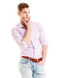 Durchdachter junger Mann getrennt auf weißem Hintergrund Stockfotografie
