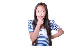 Durchdachtes asiatisches Mädchen Stockfoto