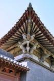 Durchdachtes Dachgesims des chinesischen alten Tempels Stockbilder