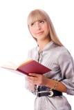 Durchdachtes Mädchen mit einem Buch Stockfotografie