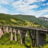 Durdevica Tara arc bridge. Mountain landscape, Montenegro. Durdevica Tara arc bridge in the mountains, One of the highest automobile bridges in Europe Royalty Free Stock Photography