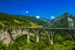 Durdevica Tara arc bridge. Mountain landscape, Montenegro. Durdevica Tara arc bridge in the mountains, One of the highest automobile bridges in Europe Royalty Free Stock Images