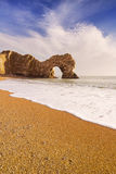 Durdle Door arch in Southern England on a sunny day stock photography