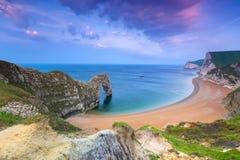 Durdle Door at the beach on the Jurassic Coast of Dorset, UK. Jurassic Coast of Dorset with Durdle Door at sunrise , UK Royalty Free Stock Image