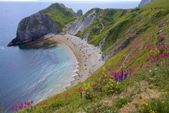 Durdle door - Beautiful beaches of Dorset, UK. Durdle Door and beaches of Jurassic coast in England stock photography