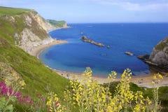 Durdle door - Beautiful beaches of Dorset, UK. Durdle Door and beaches of Jurassic coast in England stock photo