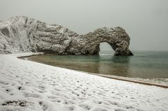 Durdle Door covered in snow on a winter morning Stock Photo