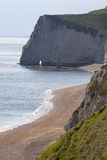 Durdle Door, Dorset. Durdle Door and beach, Dorset.  Durdle Door is a natural limestone arch on the Jurassic Coast near Lulworth in Dorset, England Stock Photos