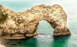 Durdle Door in Dorset. Durdle Door a famous landmark, in an area of outstanding natural beauty. Part of the Jurassic coastline running along the South Coast of Royalty Free Stock Image