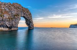 The Durdle door at the Jurassic Coast after sunset stock photography