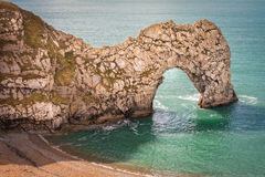 Durdle Door Jurassic Coast England. The eroded limestone rock formation known as Durdle Door, a UNESCO World Heritage site on the Jurassic Coast. Lulworth Stock Photos