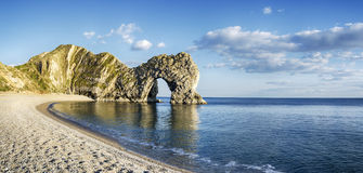 Durdle Door and Beach. Durdle Door a natural limestone arch on Dorset s Jurassic Coastline Royalty Free Stock Photography