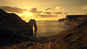 Durdle Door nature arch by sunset Royalty Free Stock Photography